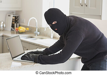 Robber at laptop