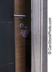 Robber behind doors