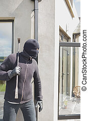 Robber hiding behind a wall