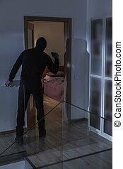 Robber in black costume - Image of robber in black costume...