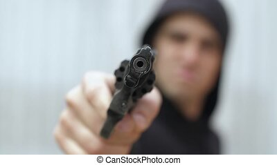 Robber pointed a gun on camera - Armed robber pointing a ...