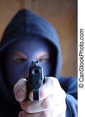 Robbery - Masked man pointing a handgun