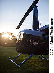 Robinson R44 helicopter ready for takeoff from a lawn
