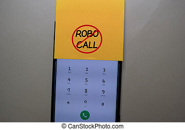 Robocall write on a sticky note isolated on office desk.