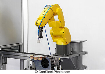 Robot arm - Robotic arm at production line in factory