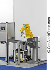 Robot at production - Robotic arm at production line in...