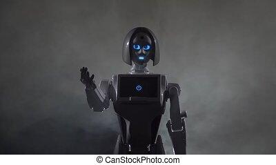 Robot calls to himself. Black smoke background . Slow motion...