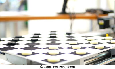 Robot checkers technologies - Robot play checkers close-up....