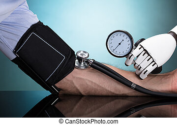 Robot Checking Person's Blood Pressure - Robot's Hand...