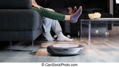 Robot Cleaning Floor While Family Watches TV Movie - Family...