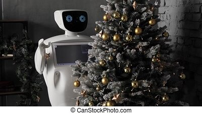 robot decorates the Christmas tree. Cybernetic system today....