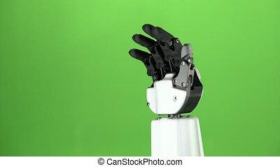 Robot hand close up waving goodbye . Green screen - Robot...