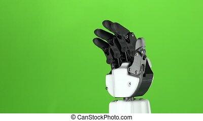 Robot hand close up waving goodbye . Green screen. Slow...