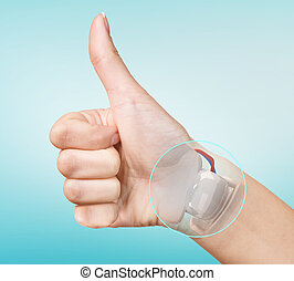 Robot hand inside human hand. Hand prosthesis concept.