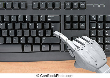 Robot hand using a keyboard - Robot hand typing on a...