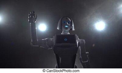 Robot hand waving bye. Black smoke background - Robot hand...