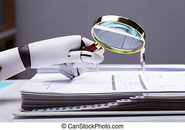Robot Holding Magnifying Glass Over Invoice