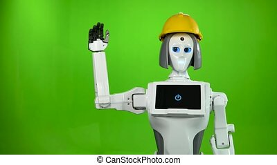 Robot in a builder's helmet waves goodbye and talks. Green screen