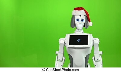 Robot in a red hat is waving goodbye. Green screen. Slow motion