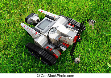 robot in action on green grass - modern technology