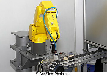 Robot in line - Robotic arm at production line in factory