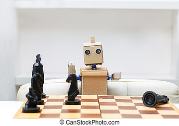 robot is sitting at a table and playing chess. Artificial Intelligence