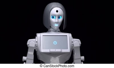 Robot leans forward. Black background. Close up - Robot is a...