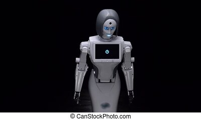 Robot leans forward. Black background - Robot is a dark room...