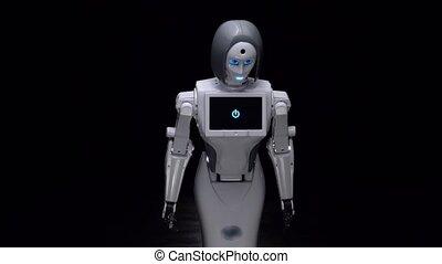 Robot leans forward. Black background - Robot is a dark room...