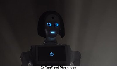Robot leaves the darkness in the room . Black smoke...
