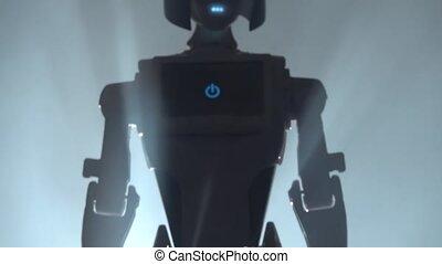 Robot leaves the smokescreen . Black smoke background. Close...