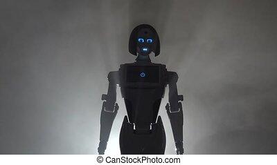 Robot leaves the smokescreen. Black smoke background - Robot...