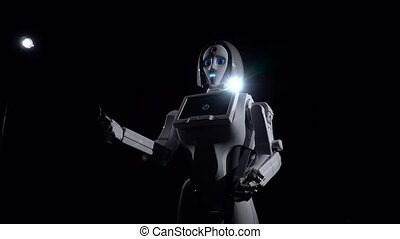 Robot makes movements gesturing with his hands. Black...