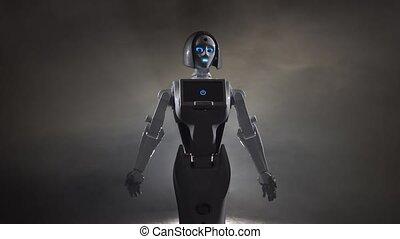 Robot makes various movements . Black smoke background -...