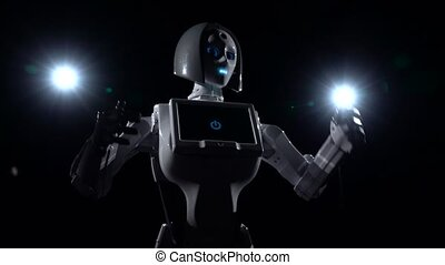 Robot moves and gestures with hands . Black background -...