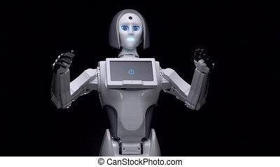 Robot speaks and gestures with his own hands. Black...