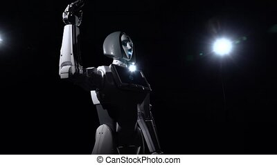 Robot talks and repeats various movements bye . Black...