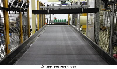 Robotic Arms and Conveyor Belt - looking down a conveyor...