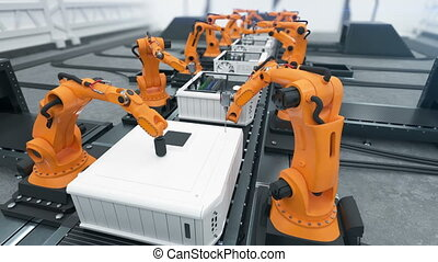 Robotic Arms Assembling Computers On Conveyor Belt Close-up....