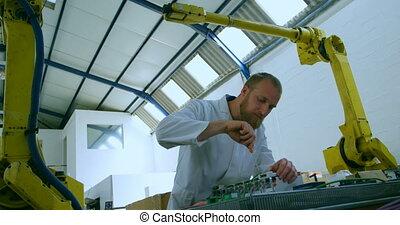 Robotic engineer repairing circuit board at table 4k