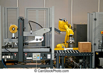 Robotic line - Packaging line with robotic arm at work