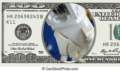 Robotic prosthetic limb arm in 100 dollar bill - Robotic...