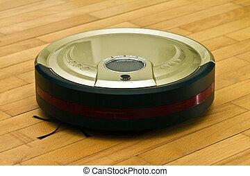 Robotic Vacuum Cleaner - A robotic vacuum cleaner on parquet