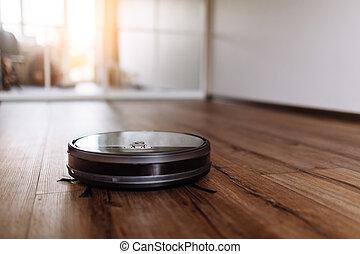 Robotic vacuum cleaner on laminate wood floor smart cleaning...
