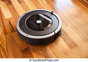 robotic vacuum cleaner on laminate wood floor smart cleaning...