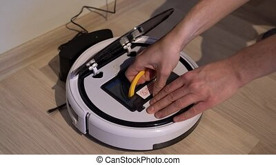 Robotic vacuum cleaner. Replace dust contaier