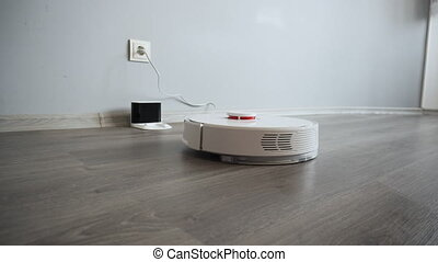 Robotic vacuum cleaner returns to the docking station for...