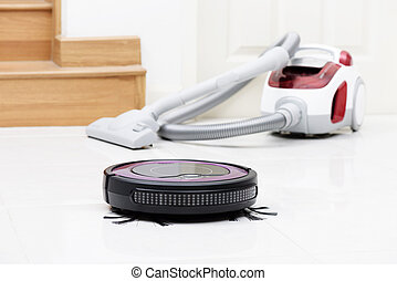 robotic vacuum cleaner on the floor, cleaning the room with...