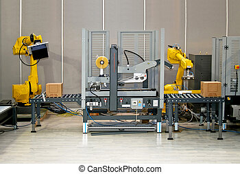 Robots at work - Two robotic hands simultaneous work at...