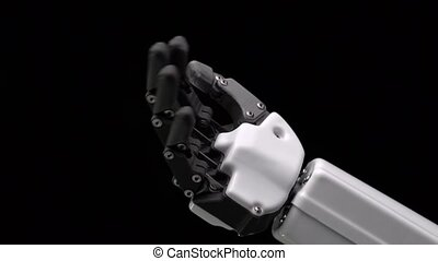 Robot's hand moves his fingers . Black background . Close...